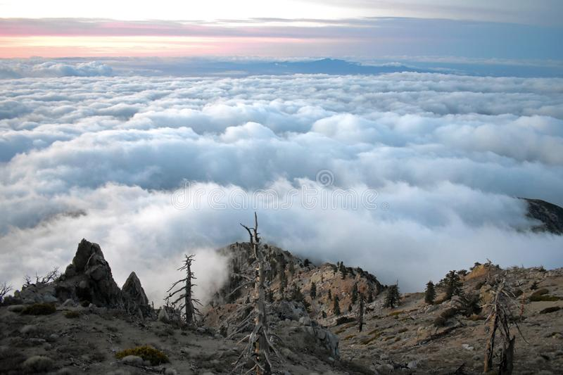 Above the Clouds from the top of a peak stock photography