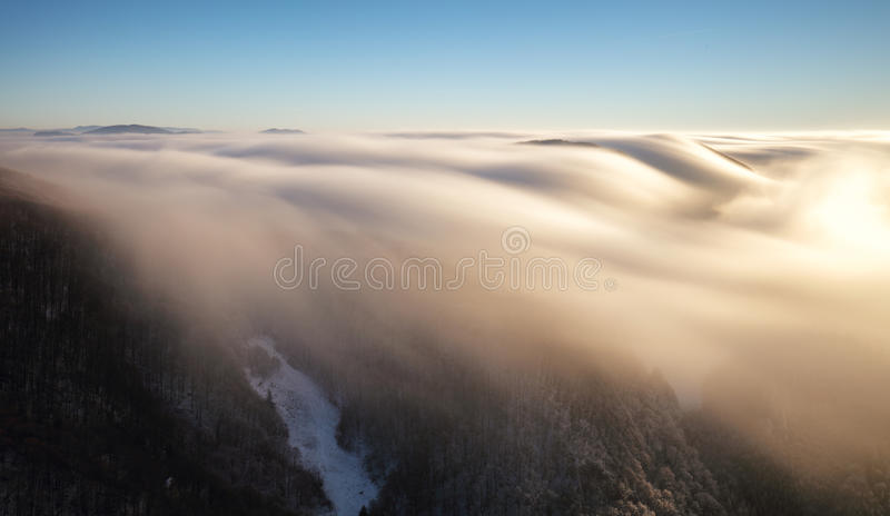 Above clouds in winter - mountain landcape at sunset, Slovakia stock photography
