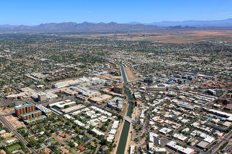 Above Downtown Scottsdale, Arizona. Aerial view above downtown Scottsdale, Arizona looking to the northeast with the McDowell Mountains in the distance stock image