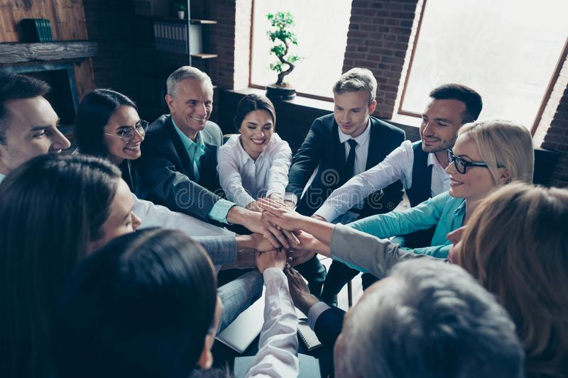 Above high angle view of nice stylish cheerful positive corporate culture company managers putting palms enjoy stock photo