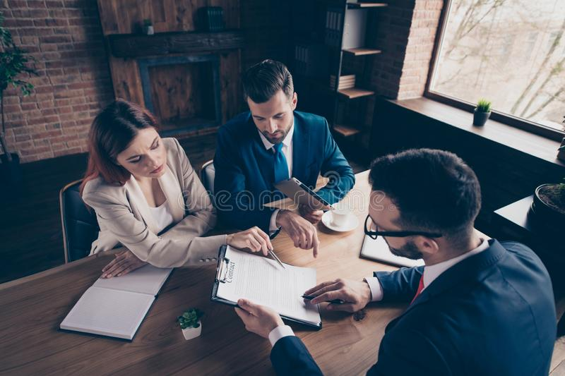 Above high angle view portrait of three nice elegant stylish trendy beautiful handsome serious minded busy executive top royalty free stock photography