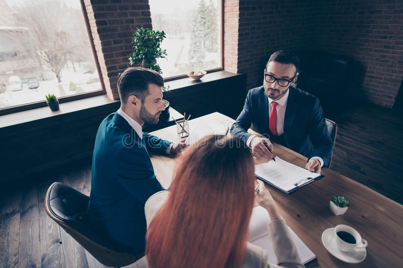 Above high angle view portrait of three stylish handsome serious busy executive top sales managers attorney lawyer royalty free stock images
