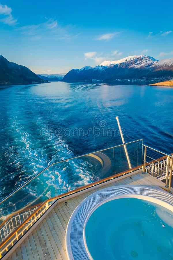 Above outdoor view of Hurtigruten voyage in cruise along Norwegian coast with a luxury swimming pool with a gorgeous. Nature background, in Norway royalty free stock photos