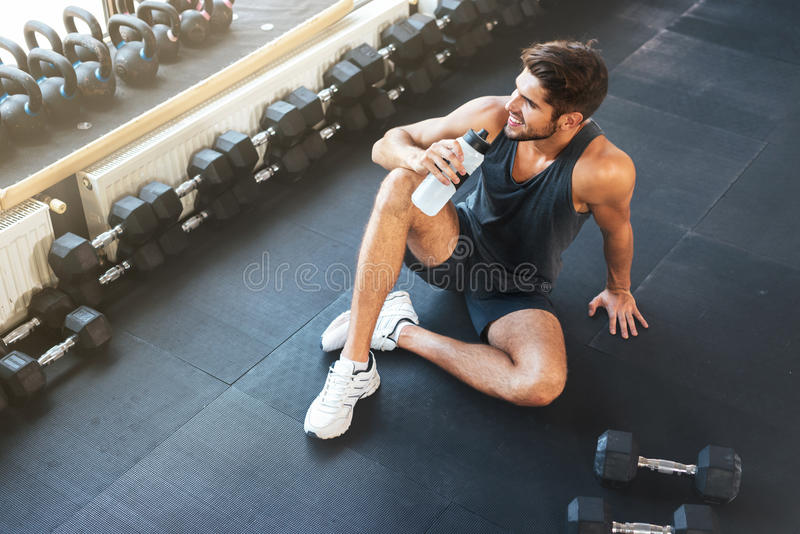 Above photo of fitness man sitting in gym royalty free stock photo