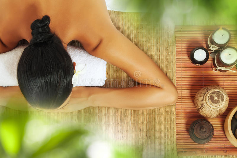 From above. Portrait of young beautiful woman in spa environment royalty free stock image