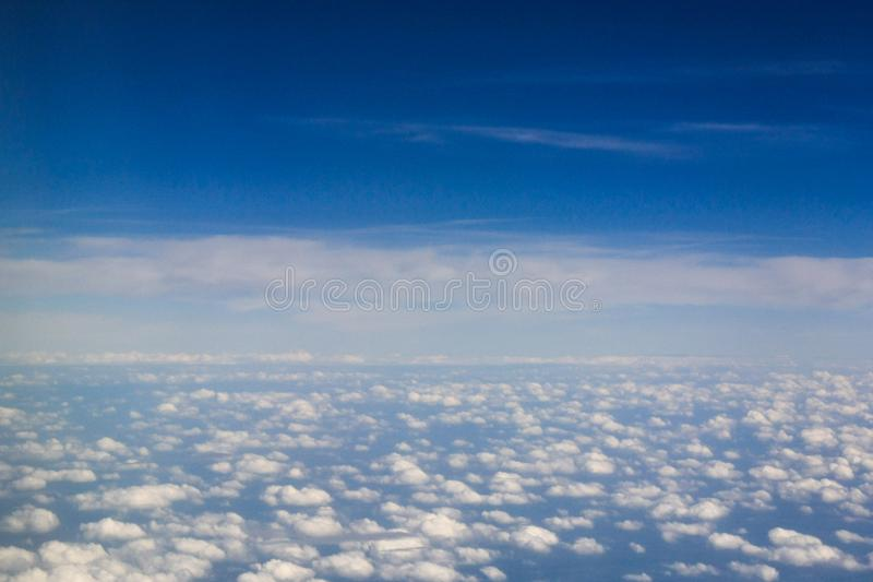 Above the sea of cotton clouds stock photo