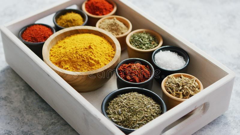 Wooden box with assortment of spices stock image