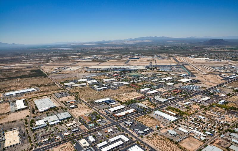 Above South Tucson, Arizona looking to the southwest at the airport and Green Valley. Aerial view of south Tucson, Arizona with mixed use business, industrial stock image