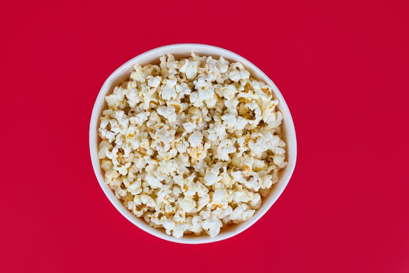 Above top overhead high angle closeup view photo of tasty yummy delicious fresh popcorn in round circle bowl isolated bright color. Background copy space royalty free stock photo