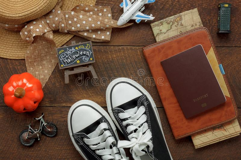 Above view of accessory Happy Halloween with items to travel background concept. Mix several object on the modern rustic brown wooden at home office desk royalty free stock images