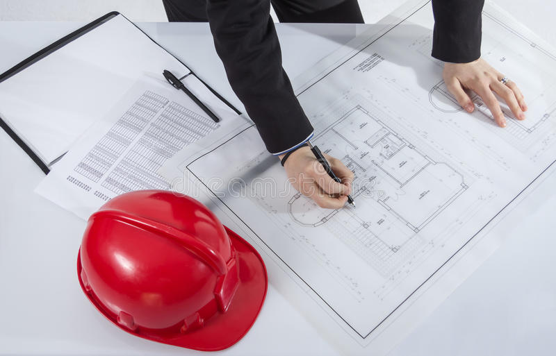 Above view of architects hands revising a house project stock photography