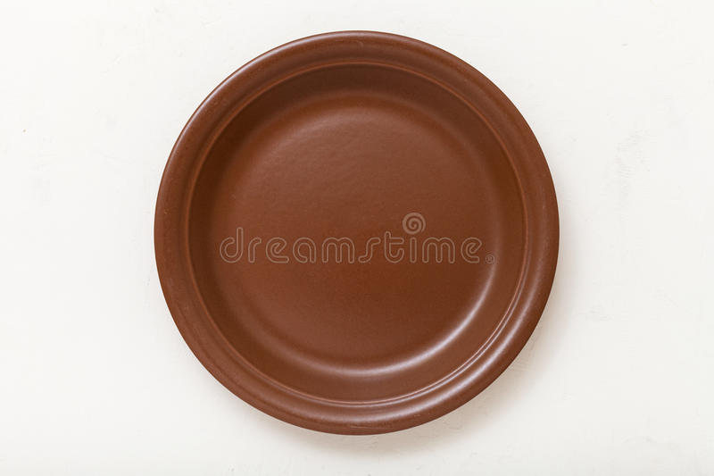 Above view brown plate on white plastering board royalty free stock photos