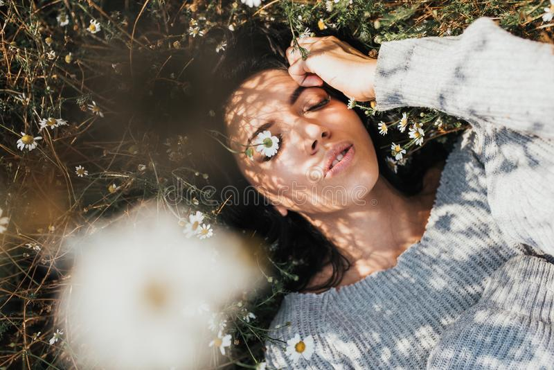 Above view of brunette young girl outdoors enjoying nature. Horizontal portrait of an attractive Caucasian woman feel free and stock photography