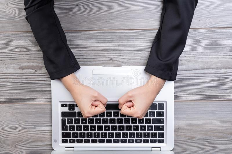 Above view of clenched fists hitting keyboard stock images