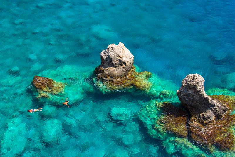 Above view of couple snorkeling in turquoise sea water, Glyka Nera, Chania, Crete. Above view of couple snorkeling in turquoise sea water, Glyka Nera, Chania royalty free stock photos