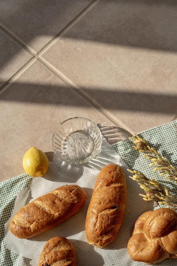 Braided bread loaves and small bread loaves. Above view of flat lay food still life with braided bread loaves and individual bread loaves royalty free stock photos