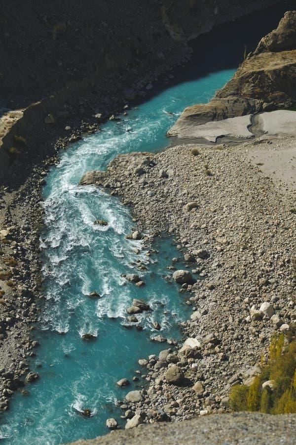 Turquoise blue river flowing through Karakoram mountain range. royalty free stock photo