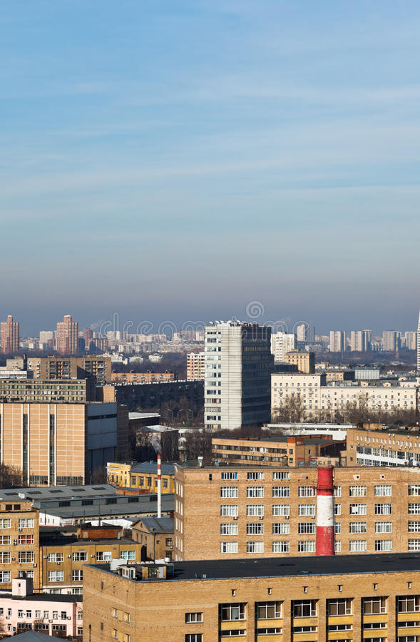 Above view of houses in megalopolis. Under blue sky stock photography