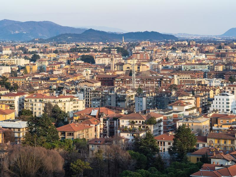 Above view of Lower Town of Bergamo with Alps. Travel to Italy - above view of Lower Town (Citta Bassa) with Alps mountains on horizon from Porta San Giacomo stock image