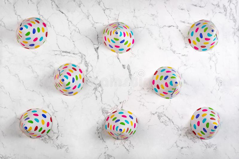 Above view on party hats on marble pattern background royalty free stock photos