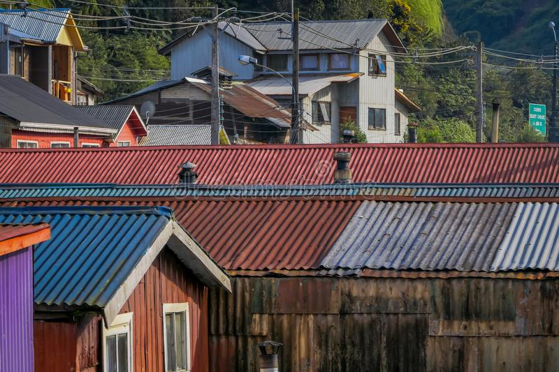 Above view of rooftop of colorful houses in the horizont located in Castro, Chiloe Island. In Chile royalty free stock photo