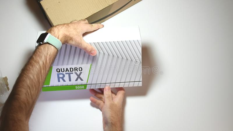 Above view unboxing of Nvidia Quadro RTX 5000 GPU. Paris, France - Feb 20, 2019: View from above POV man unboxing latest Nvidia Quadro RTX 5000 workstation royalty free stock image