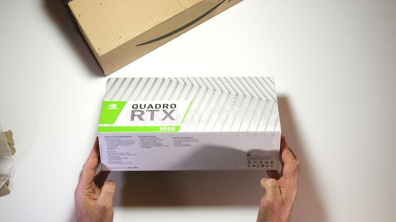 Above view unboxing of Nvidia Quadro RTX 5000 GPU. Paris, France - Feb 20, 2019: View from above POV man unboxing latest Nvidia Quadro RTX 5000 workstation royalty free stock photography