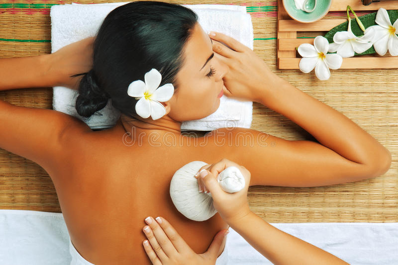 From above. View of young woman in spa environment is being massaged stock photo