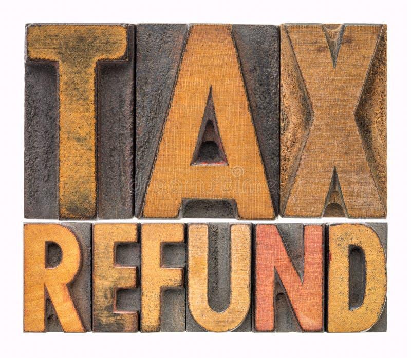 Abrégé sur mot de remboursement d'impôt fiscal dans le type en bois photo libre de droits