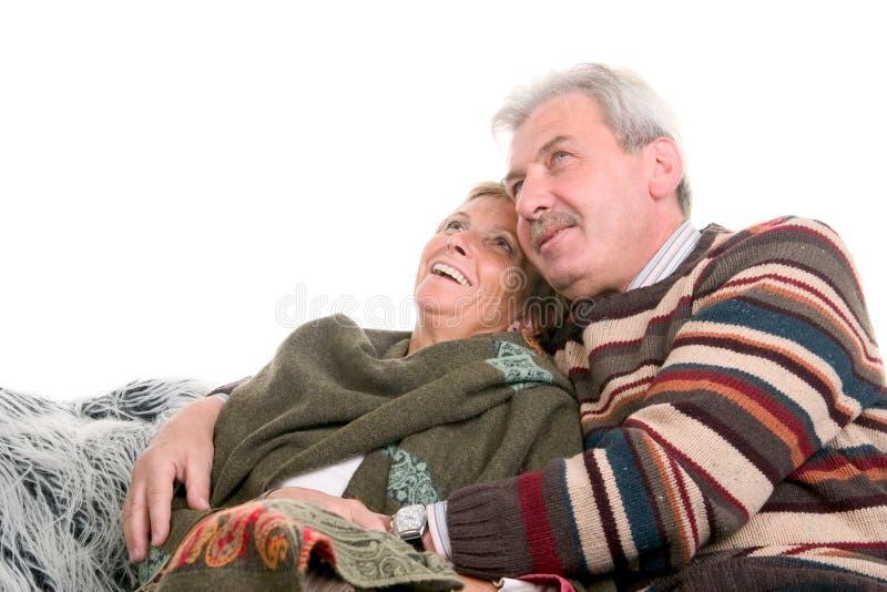 Abraçando a mulher em seus anos 50 imagens de stock