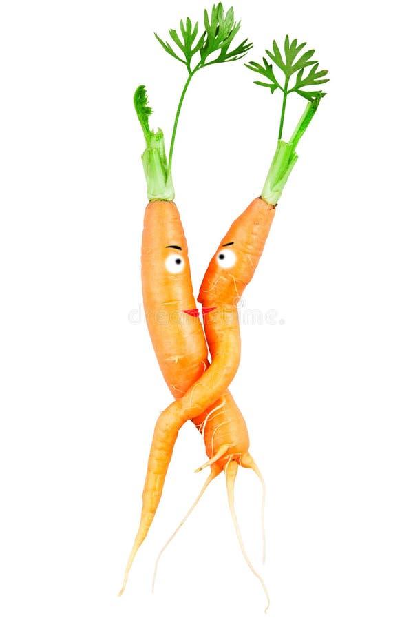 Abraço de cenouras dos pares do amor fotos de stock