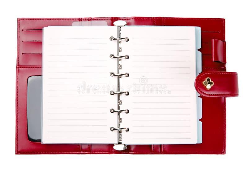Abra al planificador de cuero rojo en blanco imágenes de archivo libres de regalías