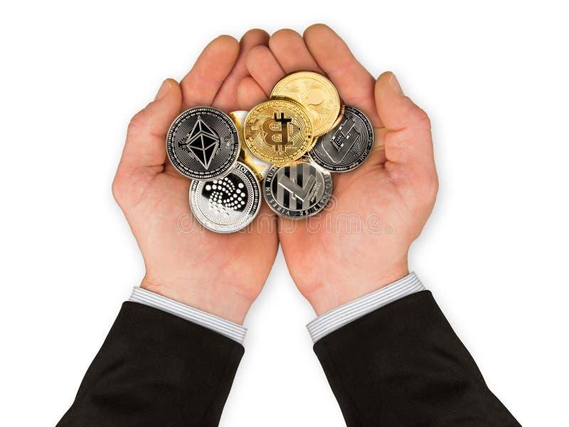 Abra as mãos com as moedas criptos da moeda fotografia de stock royalty free