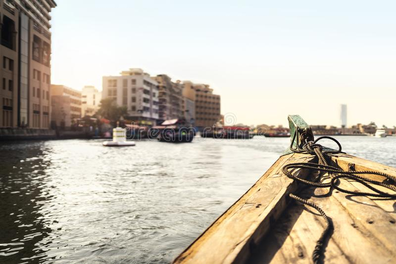 Abra boat in Dubai Creek. Water taxi in river. Passenger city view from traditional ferry. Cruising and old transportation in UAE. Travel and sailing in royalty free stock photography