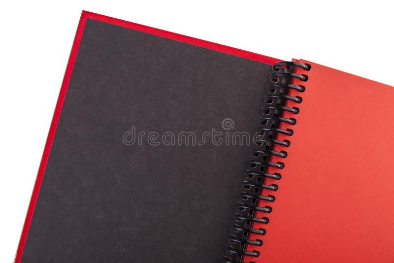 Abra el cierre de papel rojo del cuaderno foto de archivo