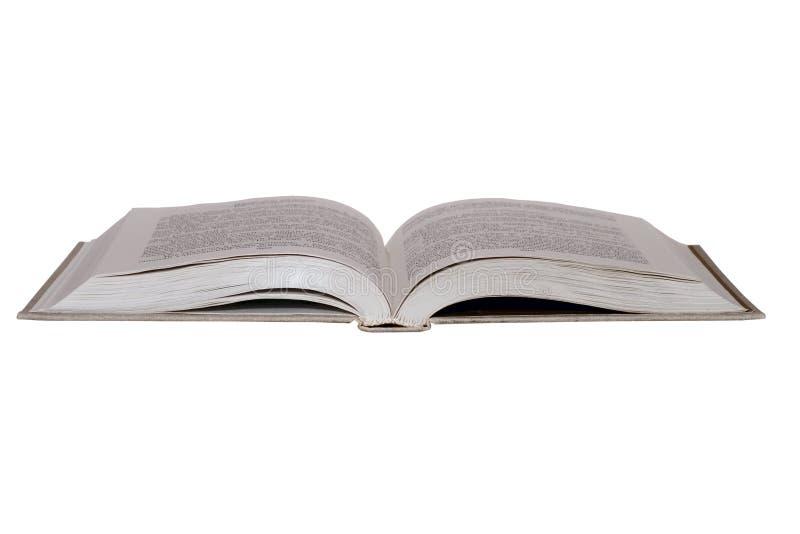 Abra el libro aislado en blanco imagen de archivo