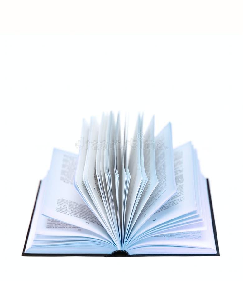 Abra el libro aislado en blanco imagenes de archivo