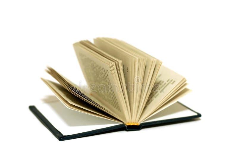 abra el libro aislado en el fondo blanco imagenes de archivo