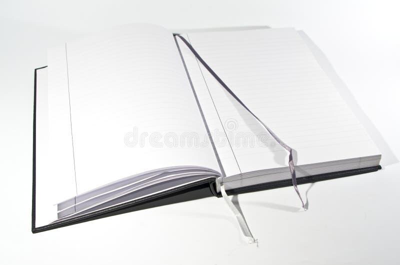 Abra el libro con las direcciones de la Internet imagenes de archivo