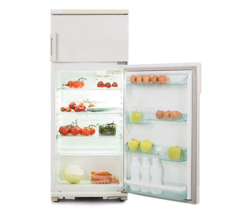 Abra el refrigerador por completo de la comida fresca y sana imágenes de archivo libres de regalías