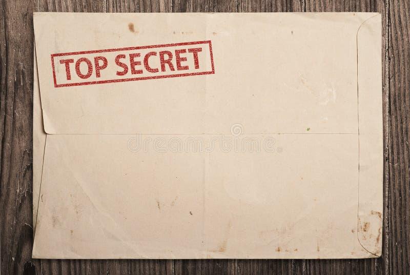 Abra el sobre secretísimo en el vector. imagen de archivo