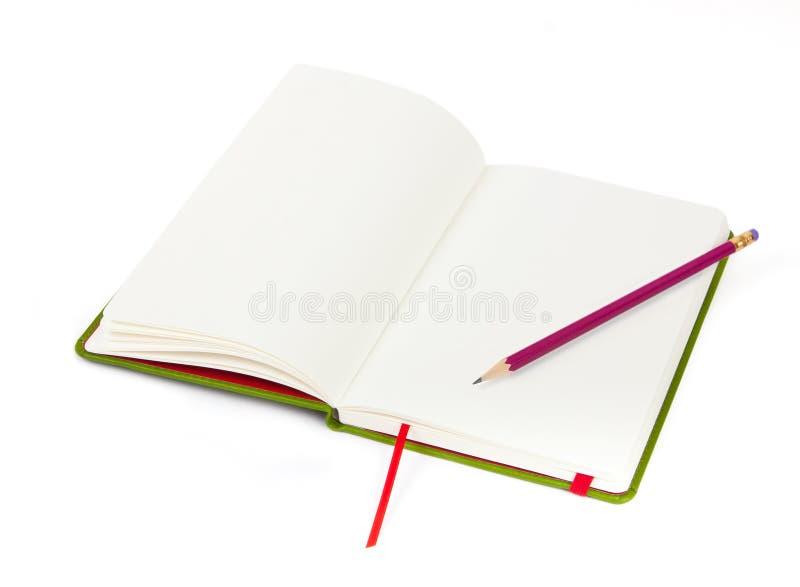 Abra o caderno e o lápis fotografia de stock royalty free