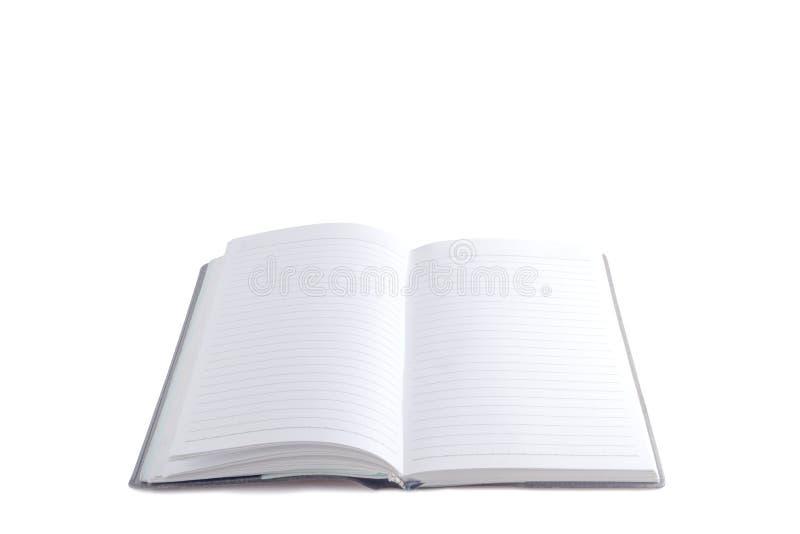 Abra o caderno no fundo branco imagem de stock