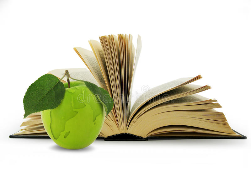 Abra o livro e o globo na maçã verde. imagem de stock