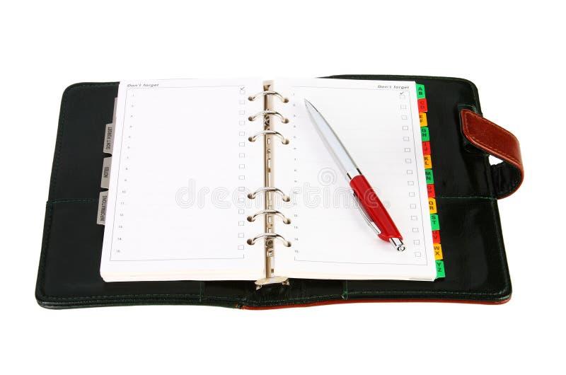 Abra o organizador de couro do escritório com uma pena vermelha foto de stock royalty free