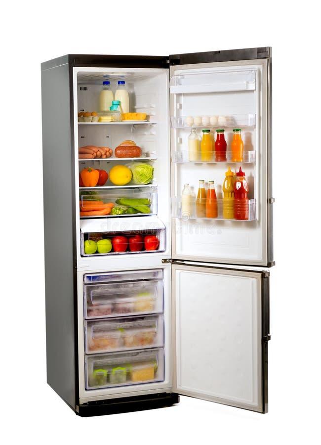 Abra o refrigerador completamente do alimento diferente fotografia de stock royalty free