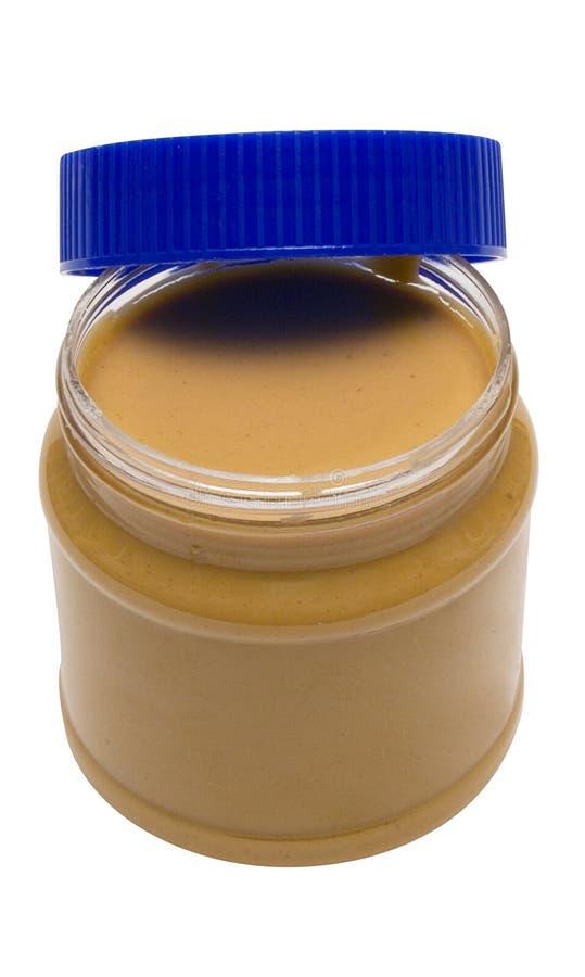 Abra o vidro da manteiga de amendoim com trajeto fotografia de stock