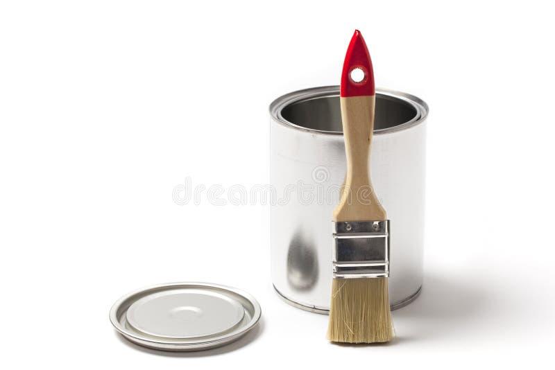 Abra Tin Paint Can com uma escova foto de stock