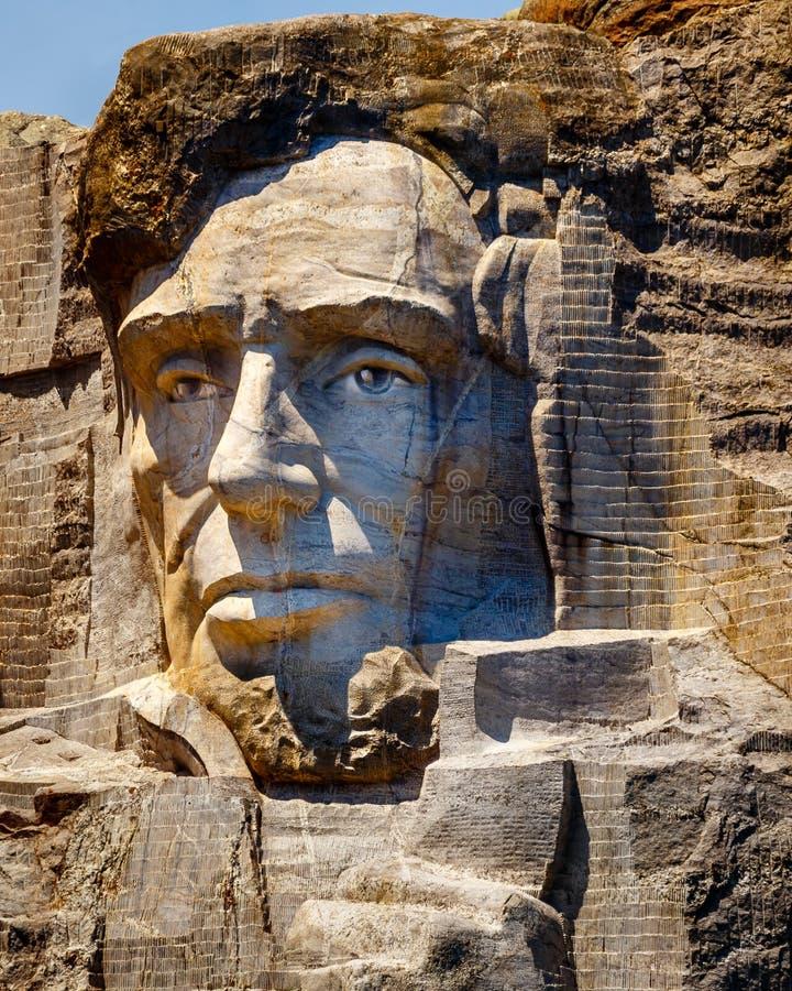 Abraham Lincoln dat op Onderstel Rushmore wordt gesneden stock afbeelding