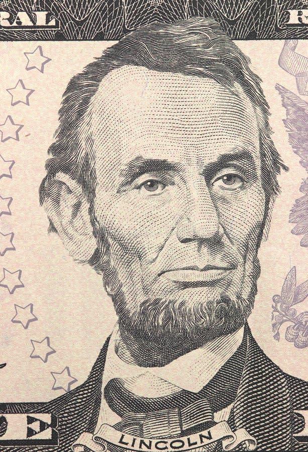 Abraham Lincoln font face sur macro de billet d'un dollar des USA cinq ou 5, plan rapproché d'argent des Etats-Unis photo stock